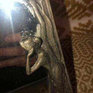 Wall Art - Vintage pewter mirror with woman looking inside it